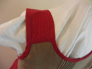 The strap is just one layer of linen.  I put the horizontal strip in to cover the rough edges