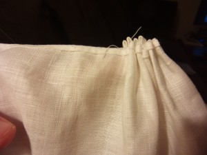 Stitch a few times across the tops of the pleats to hold them in place
